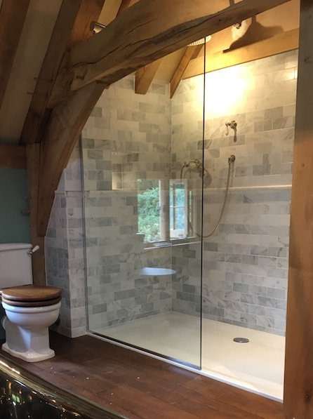 glass shower enclosure wooden beams