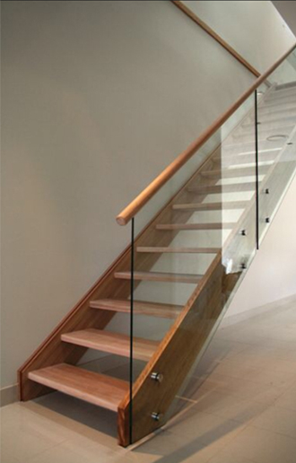 Glass balustrade stairs with wooden handrail