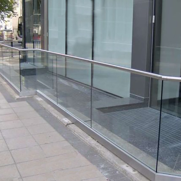 glass balustrade with steel handrail