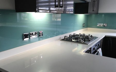 kitchen glass splashback - blue with white worktop